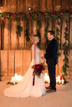 Bride & Groom in Kentucky wedding barn with hanging assymetrical floral backdrop