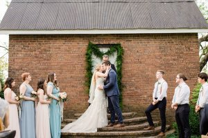 First kiss and Mr. & Mrs. in outdoor wedding ceremony