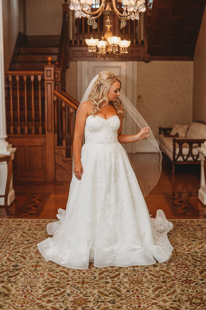 Bride in sweetheart cut, a-line dress for country glam wedding
