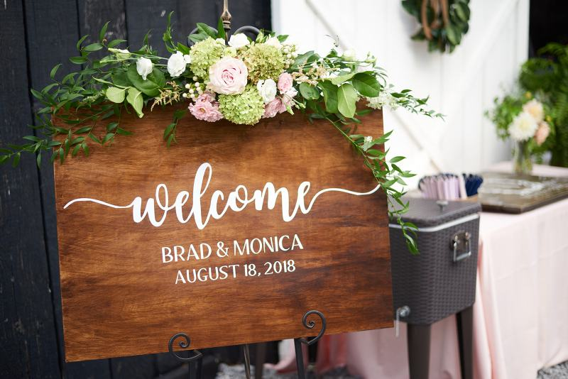 custom wood welcome sign with flowers