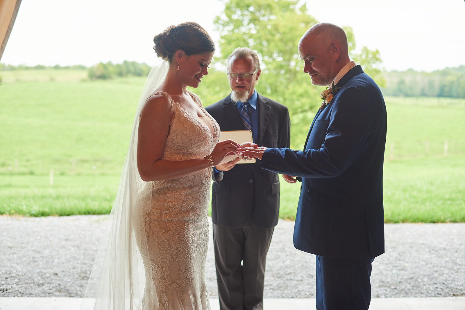 Exchange of vows at barn wedding ceremony