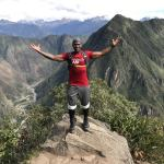 Robert Chandler at the top of Machu Picchu while on Warrior Retreats