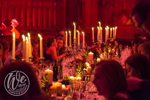 VIP Dinner with Candles and Guests Laughing