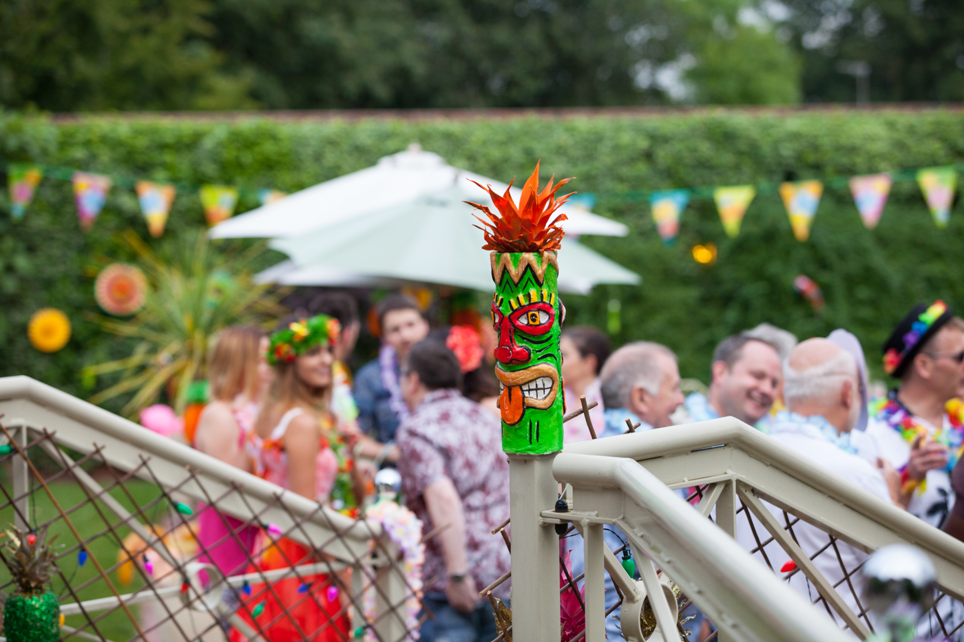 Brightly coloured sustainable event décor at Hawaiian party