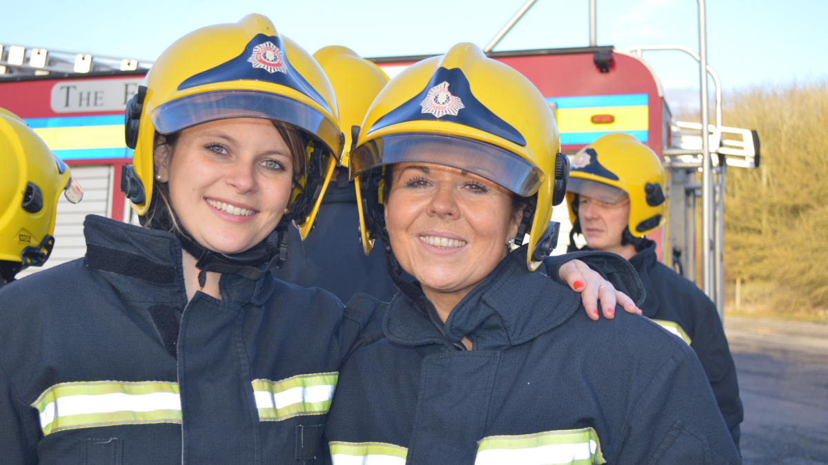 Two women during firefighting activity