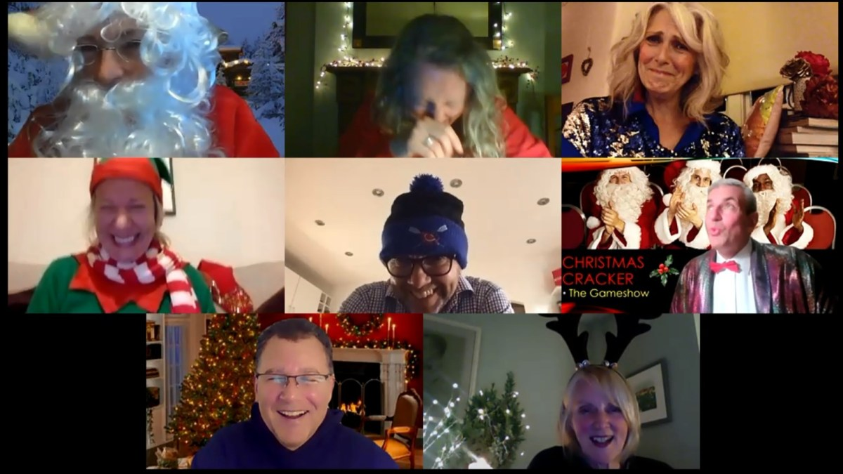 Team colleagues laughing during Christmas virtual quiz