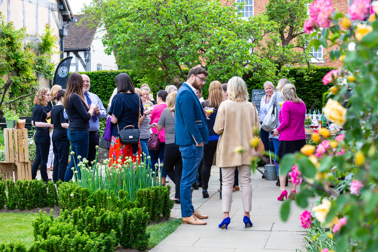 People enjoying cocktails in gardens of Shakespeare's Birthplace.