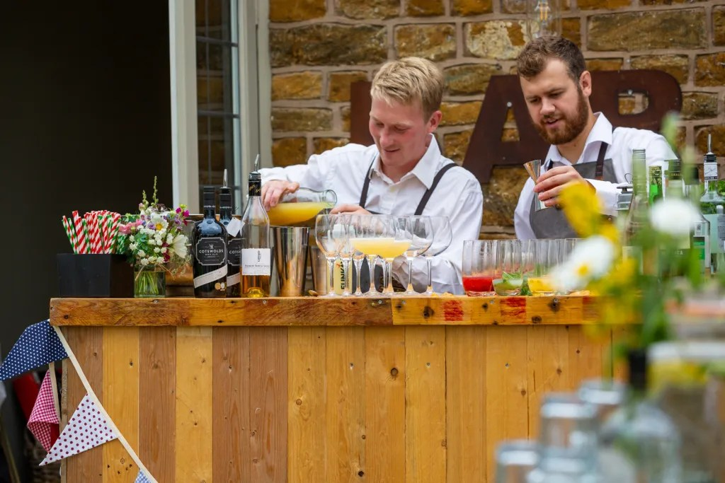 Bartenders creating cocktails at popup bar