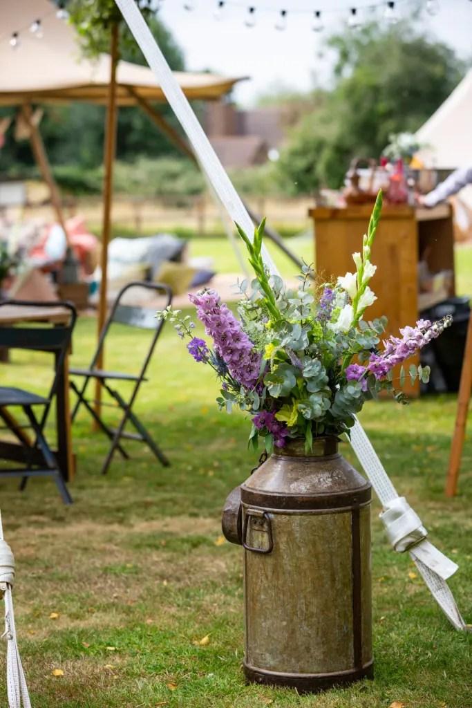Flowers in rustic milk churn