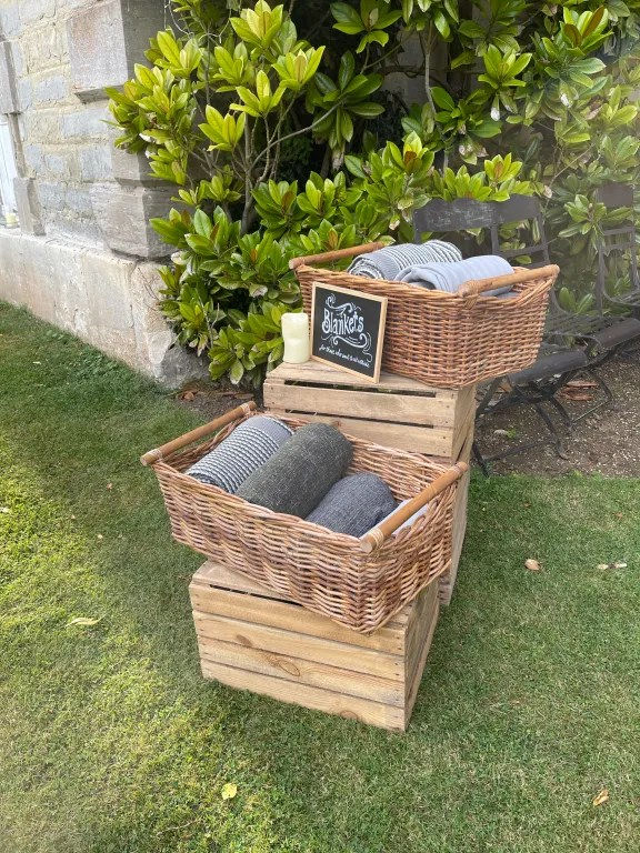 Baskets of blankets for guests at VIP hospitality event