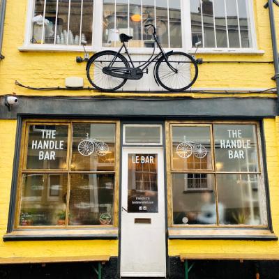 """Bike above door of yellow cafe """"The Handle Bar"""""""
