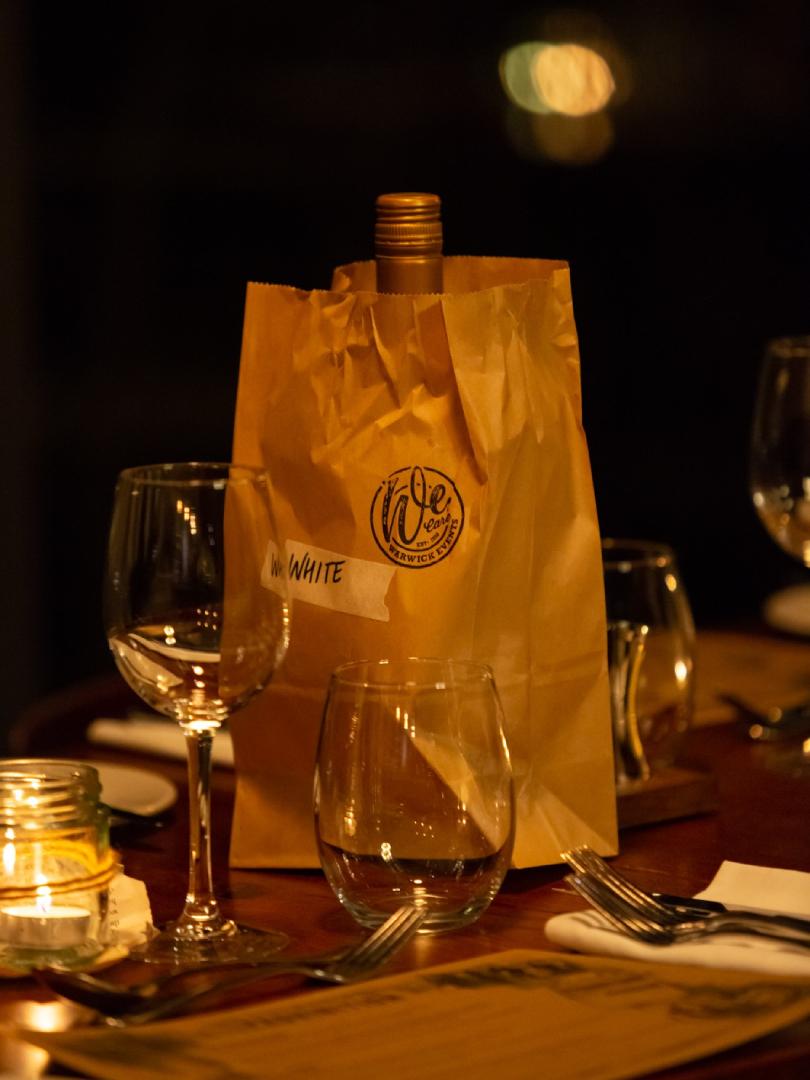 wine bottle hidden in brown paper bag