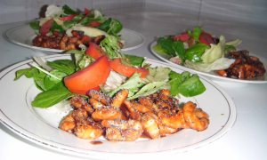 Wasabi Honey Shrimp with green salad ready for serving