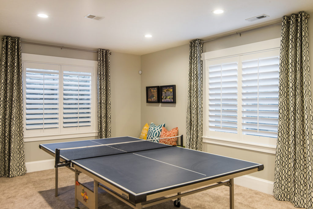 pair plantation shutters with curtains