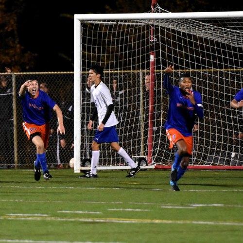 Washburn soccer players celebrating victory over Minnetonka