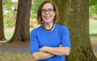 Kate Brown 2018 governor race picture outside blue shirt