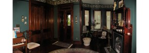 dark wood finish on doors, floor, and trim with walls painted dark green