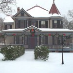 Victorian house with snow