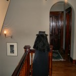 Walls are painted a pewter shade and all woodwork - banister, floors and doors are freshly finished with a dark natural look