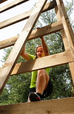 Stephanie Hamilton climbs down the wall during the Cowboy 5K