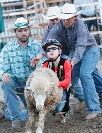 Mutton buster Jack Sharp Saturday night rodeo