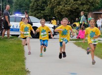 Runners from left: Annaliese Collins, Gabe Aten, Colton Scheer and Madelyn Kuhr sprint down Wilbur Street on the last leg of the Blair Kids Triathlon on Saturday.
