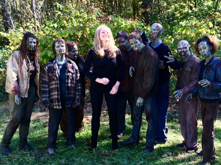 Wendy (Becker) Poischbeg, Cultural and Economic Development Manager, Snohomish County Executive's Office, with zombies on the set of Z Nation.