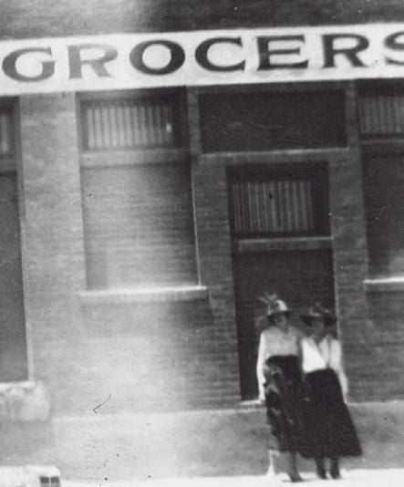 Pair of ladies in front of Wholesale Grocery