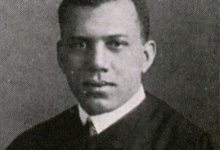 Julian H. Lewis, pictured here in 1917 in his graduation gown, was the first African-American to teach at the University of Chicago. He joined the University of Chicago faculty after earning his medical degree from Rush Medical College. (Courtesy photo)