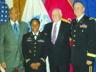 HEAF alumna Shay Stinson marks her promotion to U.S. Army major with retired Brig. Gen. George Price, HEAF founder Daniel Rose, and Brig. Gen. Robert Miller. (Courtesy of Harlem Educational Activities Fund via UNS)
