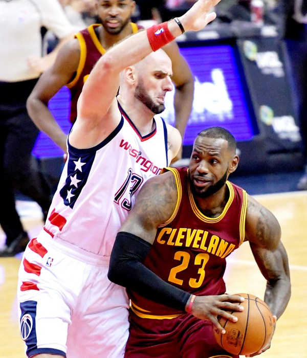 Cleveland Cavaliers small forward LeBron James is defended by Washington Wizards center Marcin Gortat during the Cavaliers' 105-94 win at Verizon Center in Northwest on Friday, Nov. 11. /Photo by John E. De Freitas