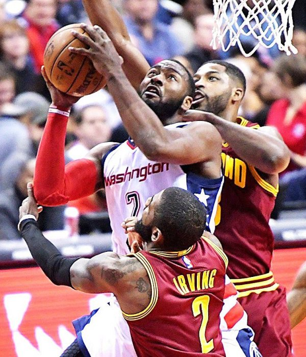 Washington Wizards point guard John Wall is double-teamed by Cleveland Cavaliers point guard Kyrie Irving and center Tristan Thompson during the Cavaliers' 105-94 win at Verizon Center in Northwest on Friday, Nov. 11. /Photo by John E. De Freitas