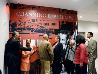 Family members of Channing Phillips attend the unveiling of a mural in his honor with D.C. Del. Eleanor Holmes Norton in the lobby of a new apartment building in Northwest on Oct. 26. Photo by Roy Lewis