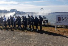 Prince George's County officials join a representative with the Peterson Companies, developer of National Harbor, for the Nov. 22 groundbreaking of a new public safety pier at National Harbor. Construction on the project will start in 2017. /Photo by William J. Ford
