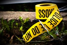 A roll of police tape (police line) lies on the ground outside a home being foreclosed on in Minneapolis, Minnesota in 2009.