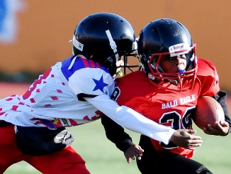 A Bald Eagle player runs for a touchdown after shedding a tackle by a Rita Bright player during a DPR Youth Tackle Football League 10U game at Roosevelt High School Stadium in northwest D.C. on Saturday, Oct. 29. Bald Eagle defeated Rita Bright 25-21. /Photo by John E. De Freitas