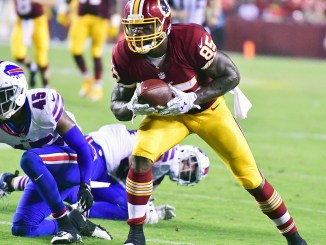 Washington Redskins tight end Vernon Davis makes a second-quarter reception during the Redskins' 21-16 preseason win over the Buffalo Bills at FedEx Field in Landover, Maryland, on Friday, Aug. 26. /Photo by John E. De Freitas