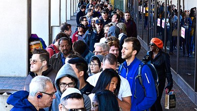 Hundreds of D.C. residents stand in line at the One Judiciary Square building in Northwest on Saturday, Oct. 22 as early voting gets underway in the city. The location is scheduled to operate from 8:30 a.m.-7 p.m. through Nov. 4. /Photo by Travis Riddick