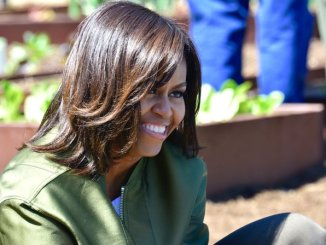 First Lady Michelle Obama is all smiles on a beautiful spring day she spends planting the White House Kitchen Garden with children invited from all over the country Tuesday, April 5, 2016. /Photo by Travis Riddick @actor_tr