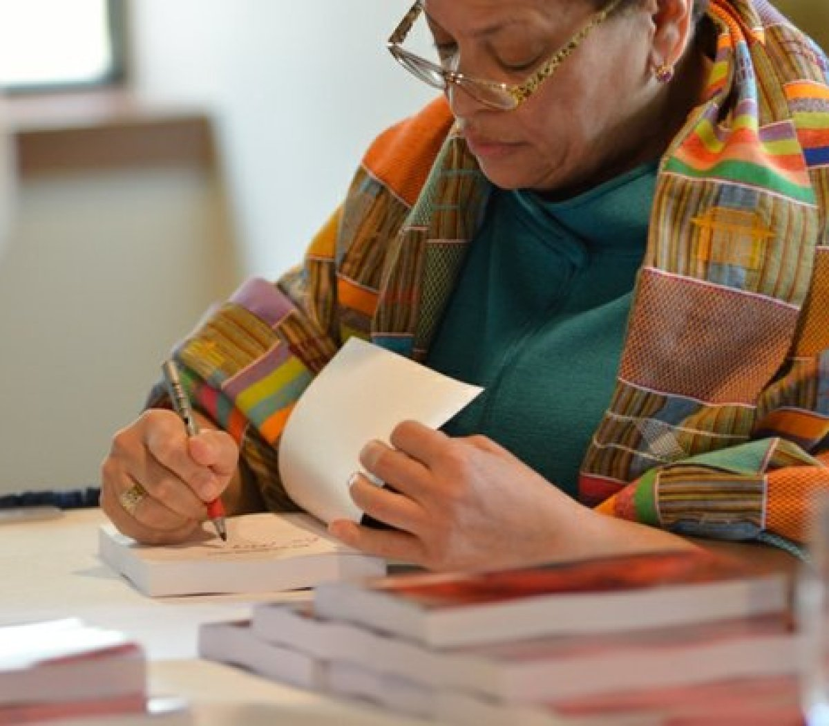 "Dr. Julianne Malveaux signs copies of her latest book ""Are We Better Off? Race, Obama and Public Policy"", at the Sixth Annual Stateswomen for Justice Luncheon at the National Press Club, Thursday, March 31, 2016 in Northwest. /Photo by Patricia Little @5feet2"