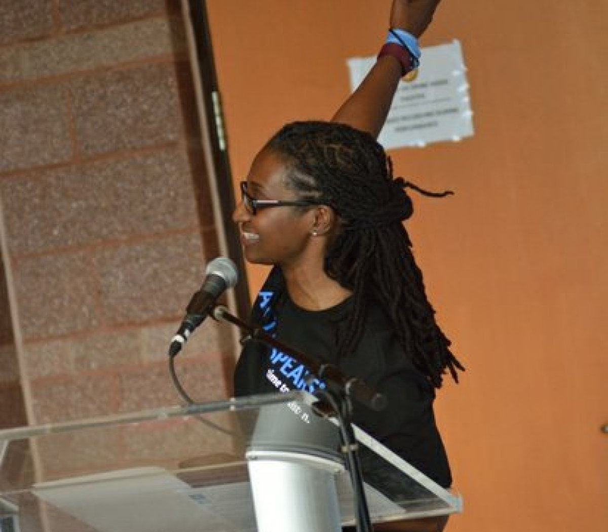 Ward 8 council member LaRuby May throws her hand up to mimmick flipping the light switch during Autism Speaks Light It Up Blue event at the THEARC, Saturday, April 2, 2016 in Southeast. /Photo by Patricia Little @5feet2