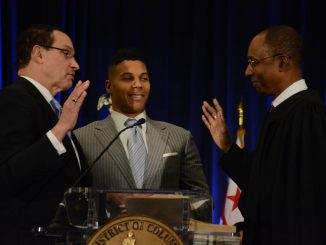 Former D.C. Mayor Vincent Gray is sworn in Jan. 2 as the Ward 7 representative on the city council at the Walter E. Washington Convention Center in Northwest. (Roy Lewis/The Washington Informer)