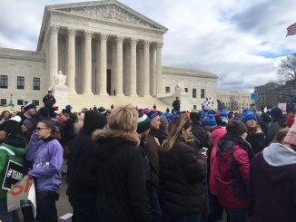 Thousands march past the Supreme Court building during the annual March for Life in D.C. on Jan. 27, 2017. (Roy Lewis/The Washington Informer)