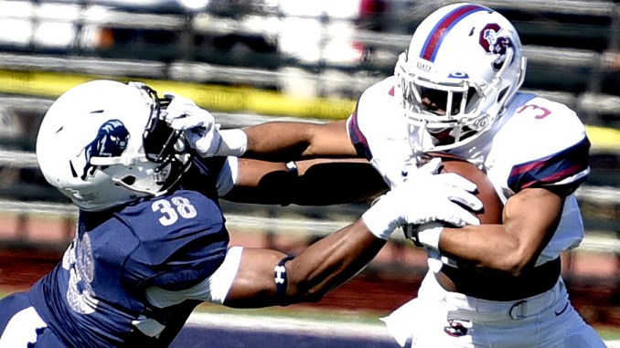 South Carolina State running back Bishop Ford stiff-arms Howard linebacker David Hudson during South Carolina State's 14-9 win at William H. Greene Stadium in northwest D.C. on Saturday, Oct. 15. /Photo by John E. De Freitas