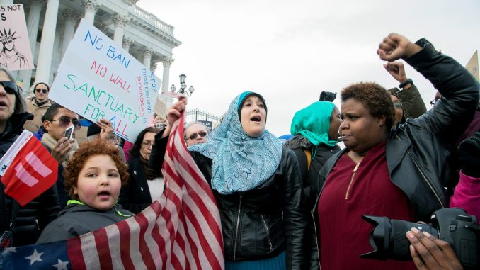 Hundreds of protesters demonstrate in northwest D.C. between the White House and Capitol against President Trump's Muslim immigration ban on Jan. 29, 2017. (Mark Mahoney/The Washington Informer)
