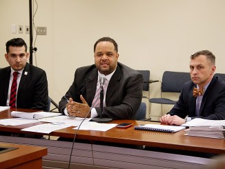 Tomas Talamante, Rashad Young, Matt Brown hold a news conference on March 20 at the Wilson Building on the impact of President Trump's proposed budget. (Lateef Mangum)