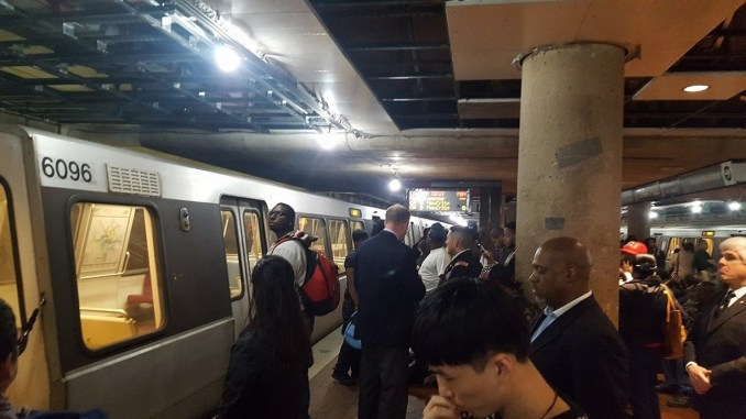 **FILE** Passengers at Metro's L'Enfant Plaza Station in southwest D.C. wait for a train on March 9 after another malfunctioned inside the station. (William J. Ford/The Washington Informer)