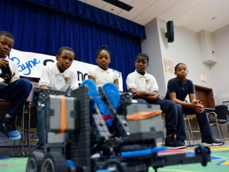 Pepco presents the Payne Elementary School Robotics Club with a $5,000 check on March 30 to pay for their expenses at the 2017 VEX Robotics World Championship in Louisville. (Roy Lewis/The Washington Informer)
