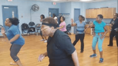 Tyra L. Pointer (left) leads a weekly Zumba class at the Camp Springs Senior Activity Center on May 19, with the participants being at least 60 years old. (William J. Ford/The Washington Informer)