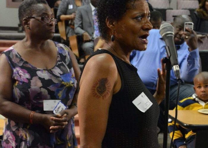 """Wilnett Stokes gives the panel her family's cancer history during the Sibley Oncology Clinic at United Medical Center's """"Cancer Awareness Day"""" in southeast D.C. on May 20, 2017. (Roy Lewis/The Washington Informer)"""